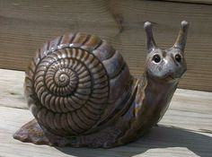 snail  browns and blues by sandsceramics on Etsy    I'm thinking I have this mold... LOL!