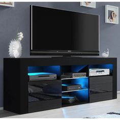 Orren Ellis Ranallo TV Stand for TVs up to 65 inches Color: Black Led Tv Stand, Tv Stand Set, Stand For Tv, Tv Stand With Led Lights, Living Room Storage, Living Room Furniture, Living Rooms, Entertainment Center, Table Tv