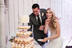 Bride and groom sneaking a wedding cupcake. Berkeley Fieldhouse Wedding, Toronto Wedding Photographer. #sweetheartempirephotography #thathairtho