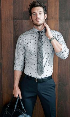 Shop this look for $178: http://lookastic.com/men/looks/tie-and-longsleeve-shirt-and-belt-and-briefcase-and-dress-pants/624 — Charcoal Paisley Tie — Grey Polka Dot Longsleeve Shirt — Black Leather Belt — Black Leather Briefcase — Black Dress Pants