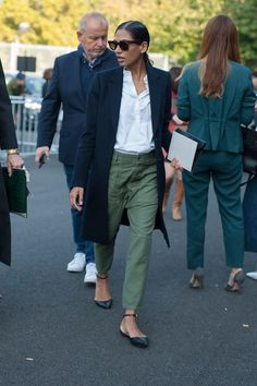 Moss green pants and navy blue coat | For more style inspiration visit 40plusstyle.com