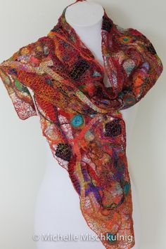 Hand dyed pure silk,silk and wool yarns, hand dyed silk fiber with free motion machine embroidery and lace. This scarf had beautiful lustre and drape.  Approx. size 22 cm x 1.95cm  All prices …