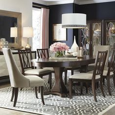"""Presidio Oval Dining Table by Bassett Furniture includes two 21"""" leaves to extend to 126"""" and seat up to 10 comfortably."""