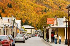 Looking down the main street of historic Arrowtown with Autumn trees covering the hills behind, Central Otago, South Island, New Zealand