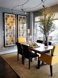 Against the gray wall color, glicées, reminiscent of midcentury modern wallpaper, add drama in the dining room of the HGTV Green Home 2011.