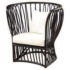 Anchor the living room seating group or patio ensemble with this handcrafted rattan accent chair, showcasing an openwork design with a high-profile back and ...