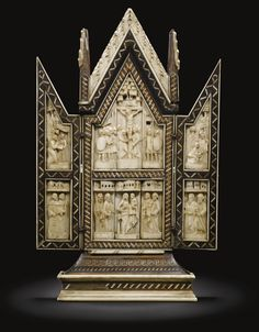 Embriachi Workshop, Italian, Venice, 15th century PORTABLE ALTAR WITH SCENES FROM THE LIFE OF CHRIST, THE VIRGIN AND CHILD AND EIGHT APOSTLES.