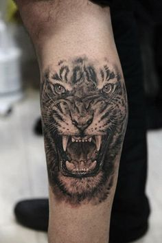 ... like black and white roaring tiger tattoo on biceps - Tattoos photos