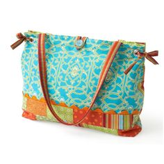 "Make an easy tote even easier by choosing a great focal print and using  precut 2-1/2""-wide fabric strips for the remainder of the bag. Use rickrack,  eyelets, and a button for a polished patchwork tote."