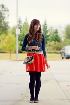 Short bright skirt, tights, and jean jacket