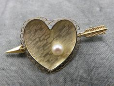 Your heart will beat double time for this sweet Krementz gold heart arrow pin with a single pearl.