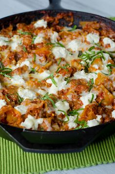 Skillet Lasagna with Garlic, Mozzarella, Parmesan, Ricotta, and Fresh Basil.