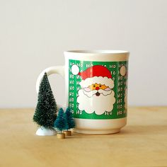 Vintage Santa Claus Mug - Ho Ho Ho - Green Red and White. $6.50, via Etsy.