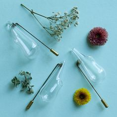 Boutonnière lapel pin vase in blown glass and brass by Omer Polak