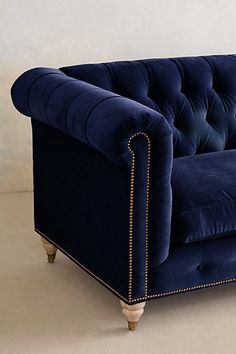 dark blue velvet sofa . Lyre Chesterfield Sofa - anthropologie.com