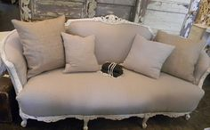 Blue lantern farm, Alpharetta, GA.  We have pretty much THIS very sofa, in need of new upholstery...  Dark gray or linen burlap??Linen Vintage Sofa-Carved wood trim