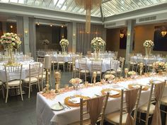 Tall blush wedding centrepieces with gold candelabras and chiffon blush chair wraps. http://www.debonairvenuestyling.co.uk