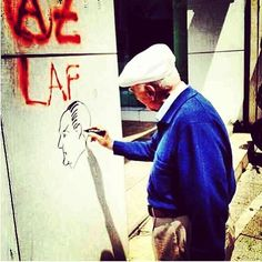 And protesters that are a little bit older. He is drawing the picture of Ataturk - founder of Turkey #OccupyGezi