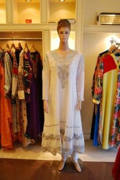 http://pakistanfashionmagazine.com/dress/pakistani-dresses/latest-casual-wear-collection-2013-for-women-by-jabeens.html