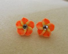 Hawaiian Flower earrings in polymer by CreationsbyMaryEllen