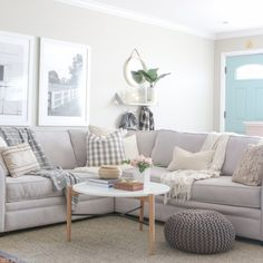 round_modern_coffee_table-couch_family_room_door