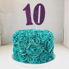 Gluten free vanilla with chocolate cream cake. For a 10 year old birthday with fondant roses in teal and purple.