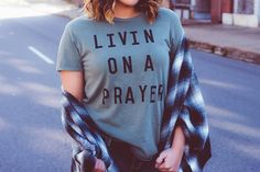 Fit: This super soft, distressed tee comes with that perfectly worn in look and feel! Fits true to size with a loose, relaxed fit and destroyed hemlines. Model is wearing a size SMALL. ***Since all it