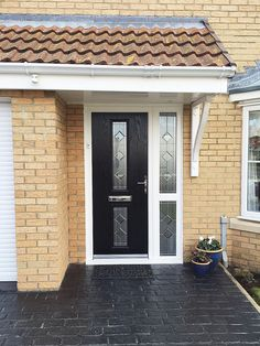 Modern and Unique Bloomberg C Design; Composite Door in Black, with Simplicity Glass Design within the Door panels, and matching  Side Panels. Simplicity Glass Design is a Diamond Bevel Design, With incorporated Textured Glass and Leaded Pattern, which offers a contemporary, fresh style.
