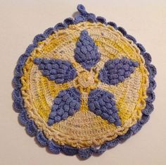 VINTAGE HAND CROCHET PURPLE AND YELLOW ROUND POTHOLDER WITH RAISED GRAPES
