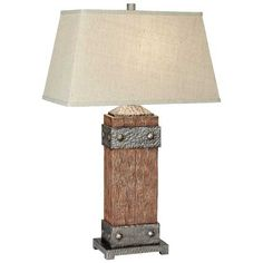 Pacific Coast Lighting Rockledge Table Lamp. Resin construction with hammered metal accents. Rectangular linen fabric shade in beige. Requires one 150-watt medium base bulb. Shade dimensions: 16L x 20W x 11.5H in. Overall dimensions: 20W x 33H in.