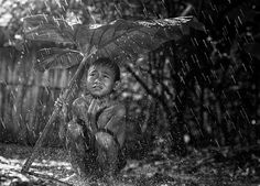Self-taught landscape and portrait photographer Herman Damar, based in Jakarta, captures everyday life in villages throughout Indonesia. Many of his lively photographs focus on children's daily adventures and their close connection with nature. Damar's photos are filled with warmth, sincerity and wise optimism.