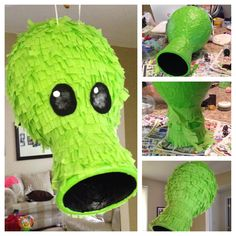 Paper mâché piñata made from a balloon, a small basket, acrylic paint, crepe paper, and felt.
