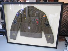 For  we present this WWII dinner jacket shadowbox we created last year! What a cool project! Military Life, Wow Products, Shadow Box, Custom Framing, Dinner Jacket, Framed Art, Picture Frames, Wwii, Cool Stuff