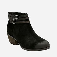 You'll want to live in this women's bootie from the Clarks® Artisan Collection. Made of soft tan suede, this western-inspired bootie has a low heel and three thin buckled straps at the ankle. A side zipper makes it easy to take on and off. A <a href=/about-clarks/cushion-plus>Cushion Plus™</a> with OrthoLite® footbed adds comfort, while a durable outsole make every step a breeze. The Gelata Siena will go with everything in your closet, from flowy winter skirts to your favorite pair of jeans…