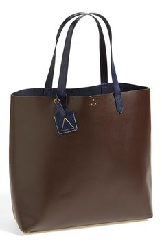 A logo-embellished luggage tag adds a hint of signature style to a simplified, workwear-inspired tote.