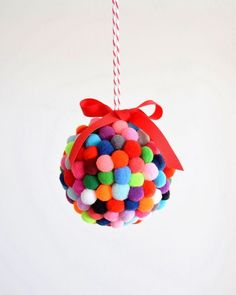 polystyrene bauble glued with pompoms and ribbon