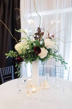 Tall centerpiece in whites, burgundy's, and greens for a cocktail style wedding reception in Seattle. Branch Centerpieces, White Centerpiece, Tall Wedding Centerpieces, Floral Centerpieces, Jewel Tone Wedding, Floral Wedding, Wedding Flowers, Wedding Reception, Wedding Ideas
