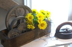 an old sewing machine drawer makes an awesome vase for flowers