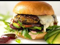 """Veggie Burger for meat lovers! Packed with so much flavour, you'll want to eat them straight out of the skillet.Low on beans, high on veggies, these vegetarian burgers have a substantial """"meaty"""" texture that's moist but never soggy."""