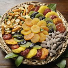 "Open, sesame!   That's what your friends or family members will say when they receive this gorgeous nuts-and fruit arrangement of sesame blend, roasted salted almonds and the most glorious dried fruit anyone would ever want to eat.  Whether it's for a ""ladies luncheon"" or a special evening get-together, this arrangement is totally right for the occasion.brbrCertified Kosher by Oregon Kosher. Documentation available upon request."