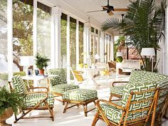 Indoor-outdoor fabric in bold colors makes a beach house porch both fun and functional. Incorporate plants in your outdoor space to further blur the boundaries between in and outdoors. (Photo: Jean Allsopp)