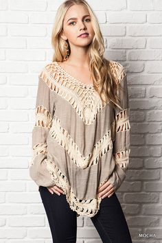 This tunic is a must-have top! We love the super chic look and loose woven crochet design. The fit is so flattering and will pair perfectly with your springtime accessories. You are sure love this tunic.
