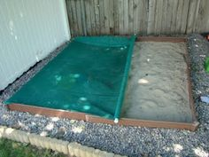 Keep your sandbox covered and clean in between playtime by creating a roll-up cover. Staple a mesh tarp to one side and sew a pocket and slide a PVC pipe on the other end. Adhere Command(TM) Hooks onto the outside of the sandbox to hold the ends of the pipe when it is unrolled