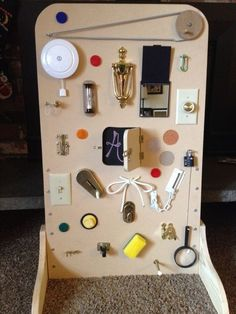 My husband is the most amazing papa! Christmas made for our 18-month-old grandson. Awesome!! Latch Board. Activity Board. MDF board Feet in flooring