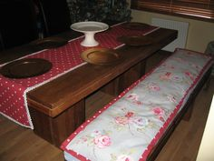 Betty Blues commissioned bench seat pad and matching table runner. Both are made from 100% cotton. The bench seat insert is a durable hardwearing foam and a microfiber pillow, with a contrasting fabric mix and satin ribbon ties. The runner is edged with an antique style lace. Please contact me through www.bettybluesvintage.com for more details