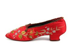 Ladies' pumps with  red satin upper decorated with floral embroidery.  			c. 1880-1900
