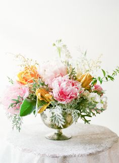 Peony, tulip, stock, astilbe, jasmine vine, lamb's ear and dusty miller centerpiece by JMFlora Design