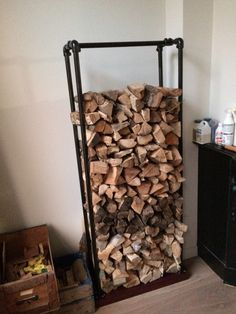 These indoor firewood storage ideas will help you pick the perfect rack for your firewood, keeping your home beautiful without leaving you broke. Indoor Log Storage, Indoor Firewood Rack, Firewood Holder, Firewood Storage, Recycled Trampoline, Pipe Table, Into The Woods, Pipe Shelves, Build Something