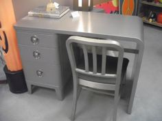Streamline metal desk and chair, Norman Bel Geddes, 1930s. Love the industrial furniture of the Deco era
