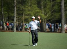 U.S. golfer Fred Couples waves after chipping on to the 13th green during the second round of the Masters golf tournament at the Augusta National Golf Club in Augusta, Georgia April 11, 2014. REUTERS/Mike Blake
